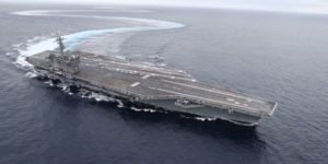 US Navy Aircraft carrier makes tight turns.